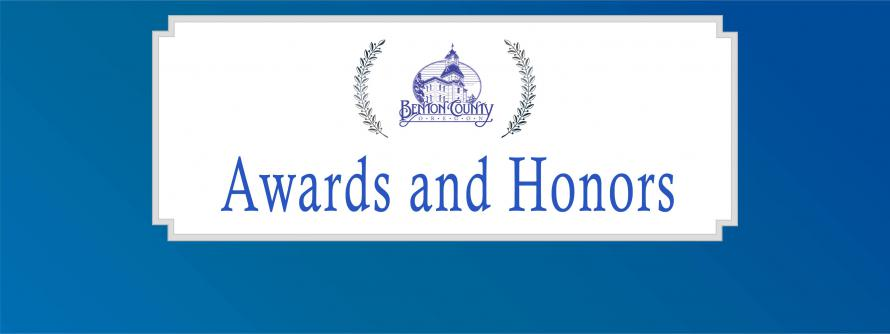 Blue banner with Awards and Honors circling the Benton County logo.
