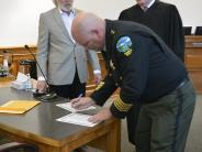 Sheriff Scott Jackson signs