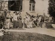 Circa 1911 Photo of people sitting on the courthouse steps