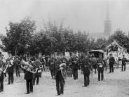 Photo of old Presbyterian Church in background of Eugene Fireman's Band