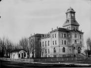 1897 Photo of courthouse with original jail, chimneys, metal work, and fence