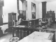 1905 photo of County Clerk Victor Moses in his office