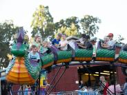 Kids riding on a dragon roller coaster