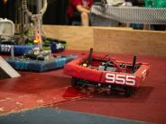 Three robots in competition at the fair