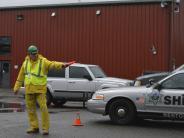 CERT volunteer directing traffic at Drug Take Back Event.