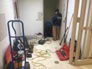 Repairing water leak.