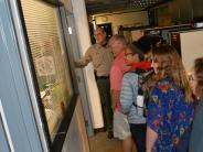 Citizens' Academy participants get a tour of the Law Enforcement Building.