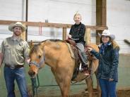 Posse members offer horseback rides in exchange for smiles!