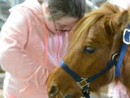 Special Needs Ride participant bonds with pony.