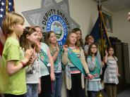 Girl Scouts get a tour of the Sheriff's Office.