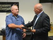 Sheriff Jackson congratulates Deputy Randy McInnes on retiring after 18+ years of service.
