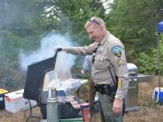 Cpl. Schermerhorn checks on the hamburgers.