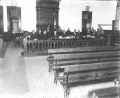 Black & White Photo of People in Courtroom