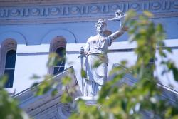Lady Justice statue on Benton County Courthouse