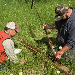 Andy Gallagher, Red Hill Soils, works with OSU student, Logan Bennett, to classify a prairie soil