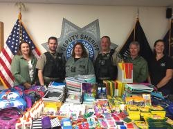 Benton County Sheriff's Office employees collect school supplies to deliver to rural Benton County schools