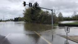 The closed intersection under water where Hwy 20 and Hwy 34 join on the east side of the Willamette River