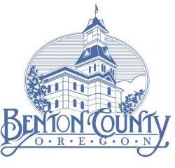 Benton County, Oregon blue logo with county courthouse in front of trees and a blue sky