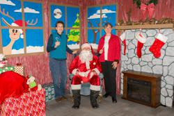 """Commissioners Schuster and Augerot with """"Santa Claus"""""""